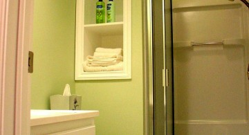 tiny bathroom design ideas in green with accordion glass door