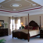 tray ceiling bedroom with four posts bed