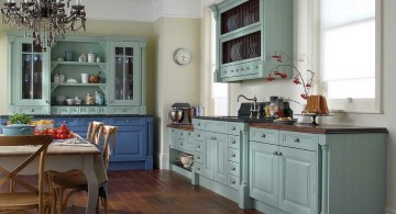 vintage and retro kitchen design with wooden floor and green cabinets