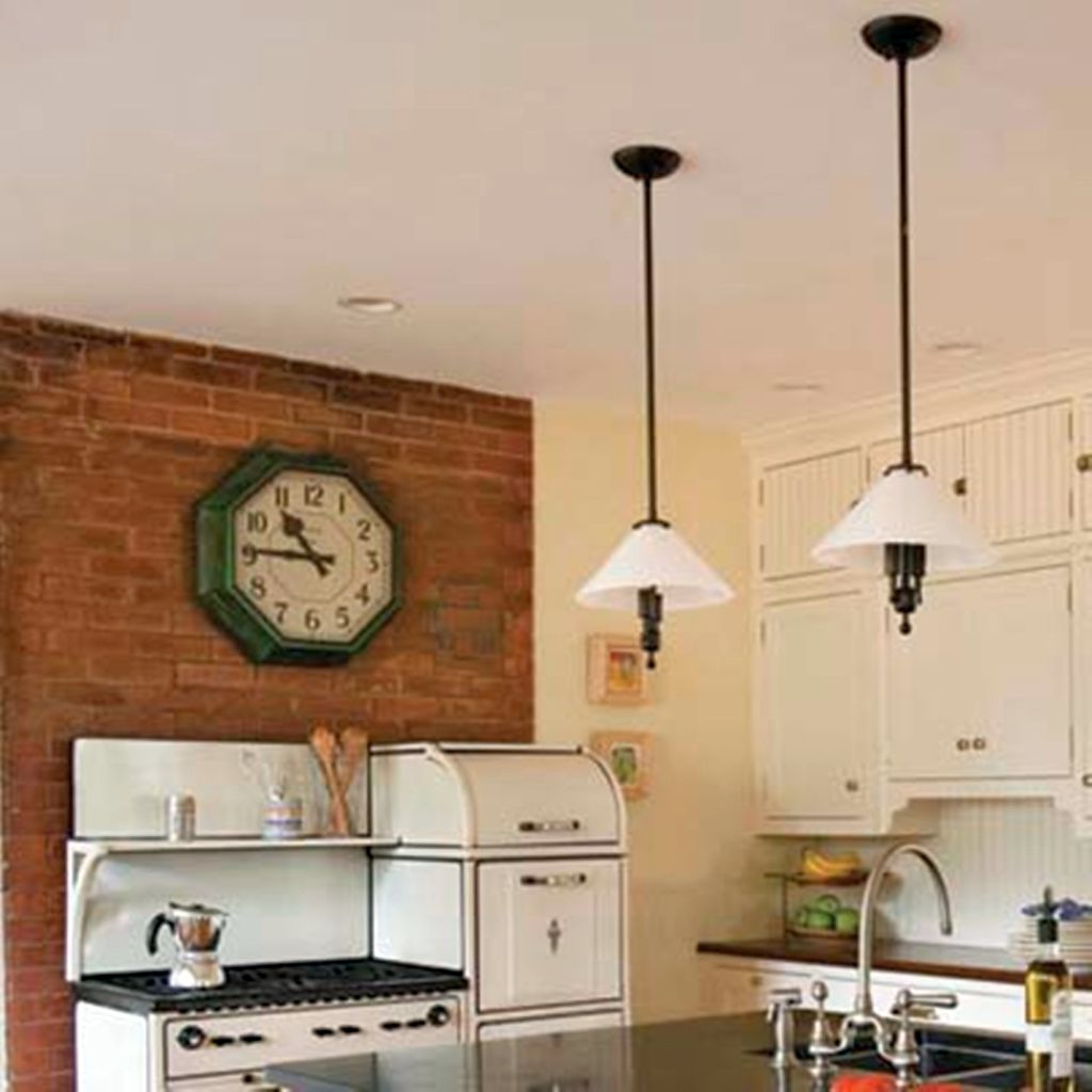 vintage mini pendant lights over kitchen island