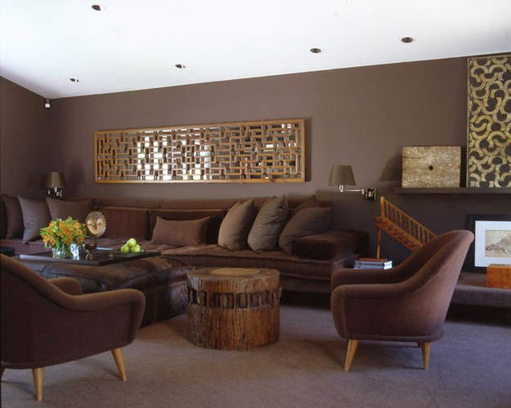 Warm earth tone living room in dark colors for Earthy apartment decor