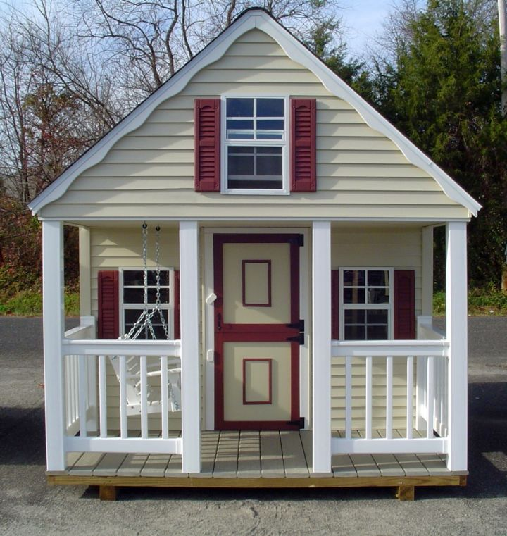 white cottage with swing at the porch luxury outdoor playhouse