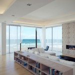 wide modern white fireplace design for wide space