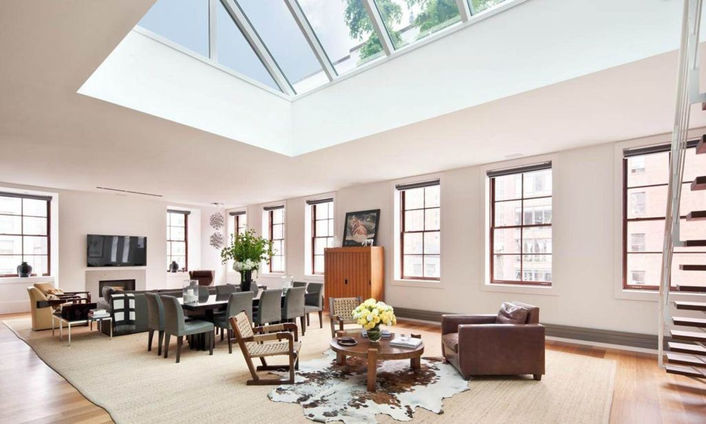 wide open living room with skylight ideas