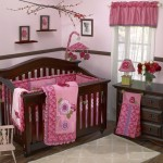 pink baby room ideas with wall art and wooden theme
