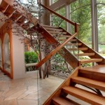 wooden staircase designs with glass and wood railings