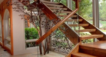 wooden stairs with clear glass railing