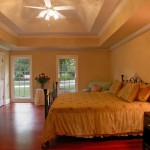 yellow toned tray ceiling bedroom