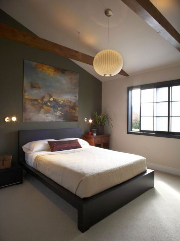 Asian bedroom with platformed bed and pendant light
