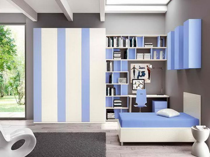 Boys room color striped blue and white with grey sofa