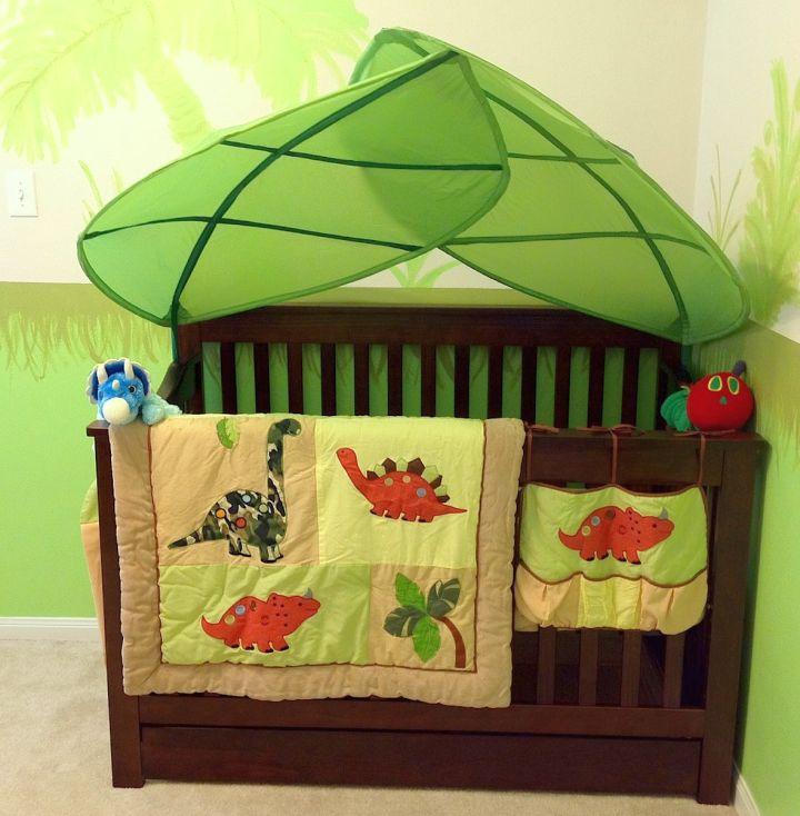 Dinosaur themed bedroom for baby crib