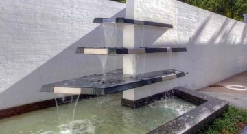Great image of modern water feature design using tiered glass fountain