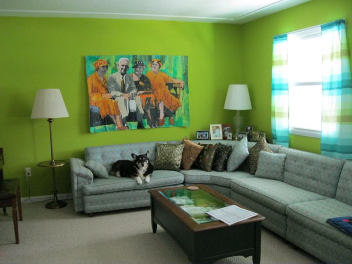 Grey and green living room with L shaped sofa and green wall