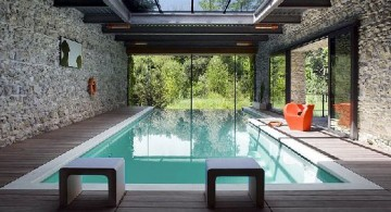 Luxurious Enclosed Swimming Pool Surrounded by Naturally Textured Wall