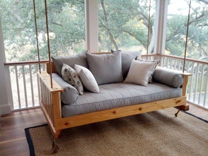 Outdoor swinging beds in gray