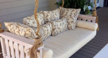 Outdoor swinging beds in white