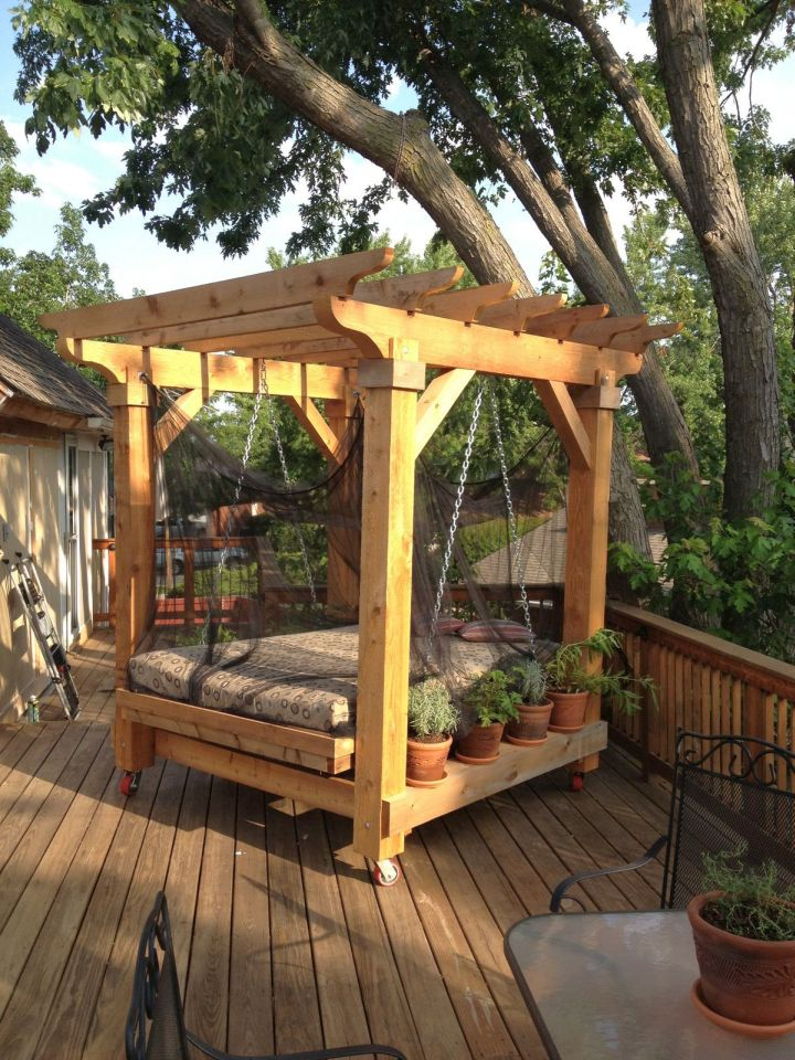 18 restful outdoor swinging bed designs for Diy patio bed