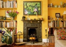 Tuscan living room decor for small rooms featuring yellow wall painting and warm vintage interior decoration