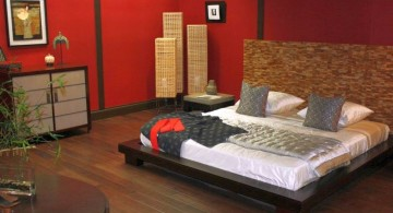 asian inspired bedroom with red walls and wooden floor