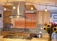bright and lovely track lighting idea over kitchen island with marble countertop
