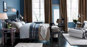 brown and blue bedroom with dark wood floor