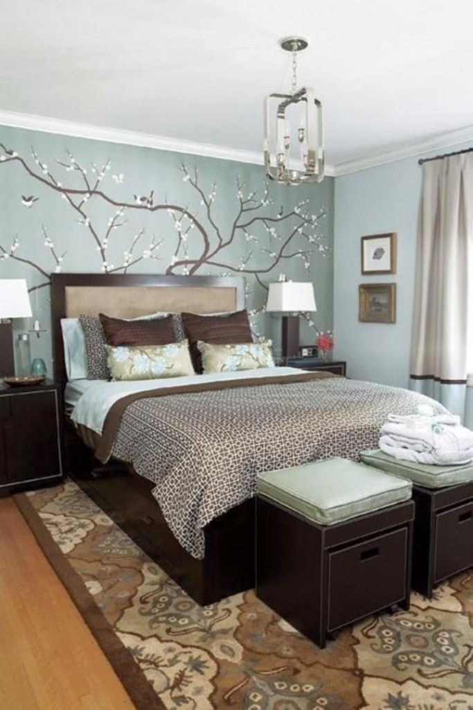 brown and blue bedroom with flower rug