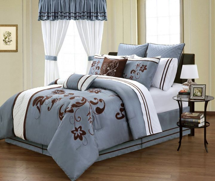 brown and blue bedroom with lovely bedding pattern