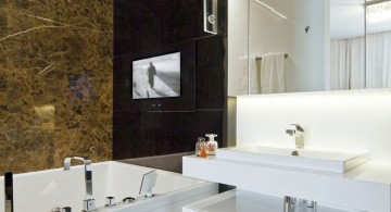 brown bathrooms with built in TV on the wall