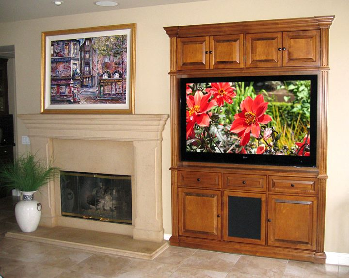 built in TV next to fireplace