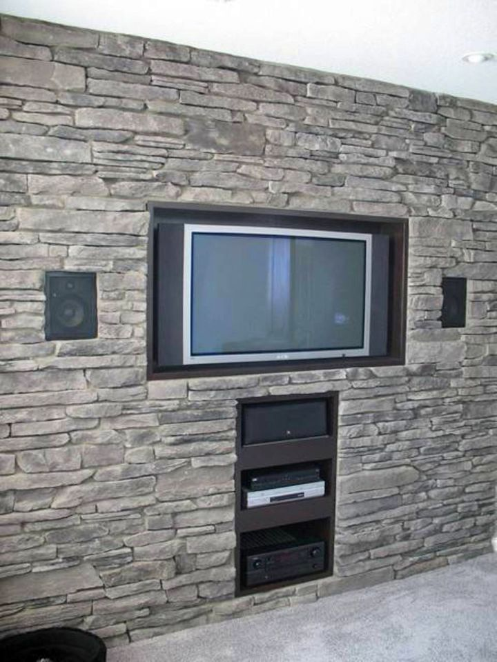 Built In TV On Textured Stone Wall