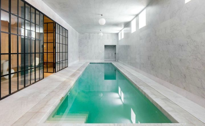 contemporary indoor lap pool with glass door