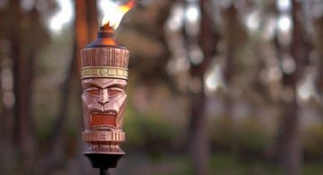 cool tiki torches featuring unique ethnic mask design