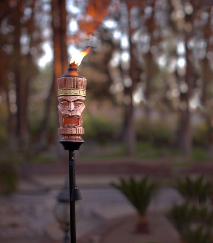 cool tiki torches with tiki mask