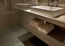 cutting edge modern floating sink design with shelf underneath