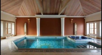 enclosed swimming pool with rustic ceiling