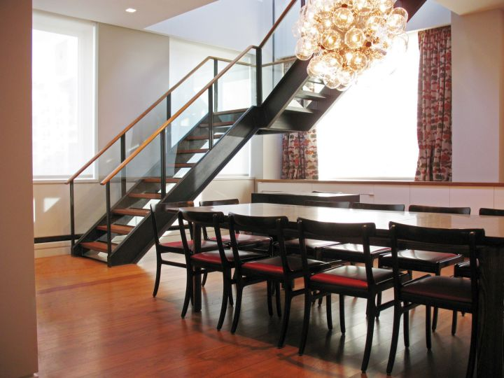 floating wood staircase with black railings