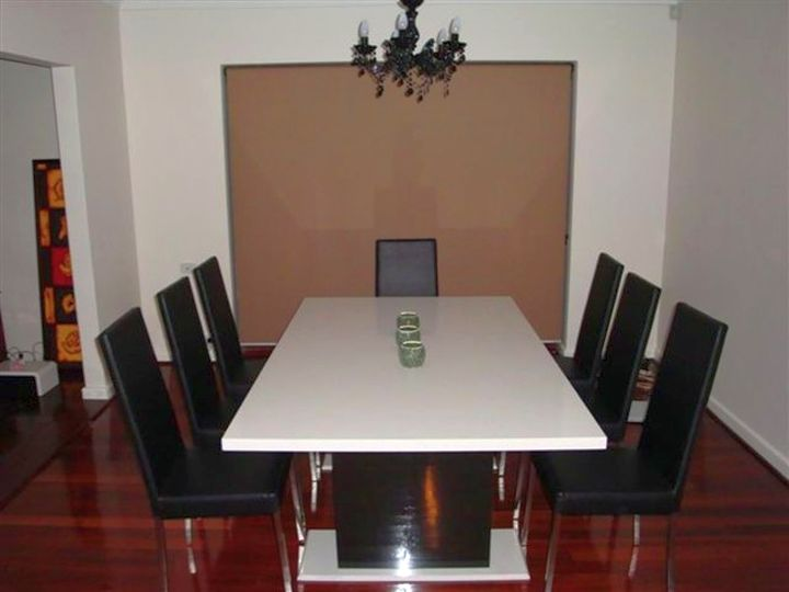 granite dining room table in monochrome