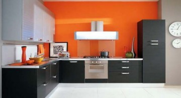 grey and black contemporary modular kitchen idea with bright and sweet orange splash