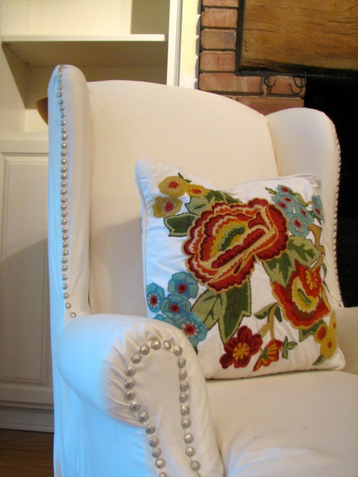 high end slipcover with buttons detail