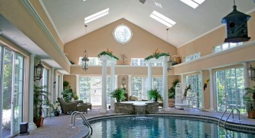 homes with indoor pools with pendant lamps