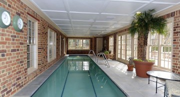indoor lap pool with brick walls