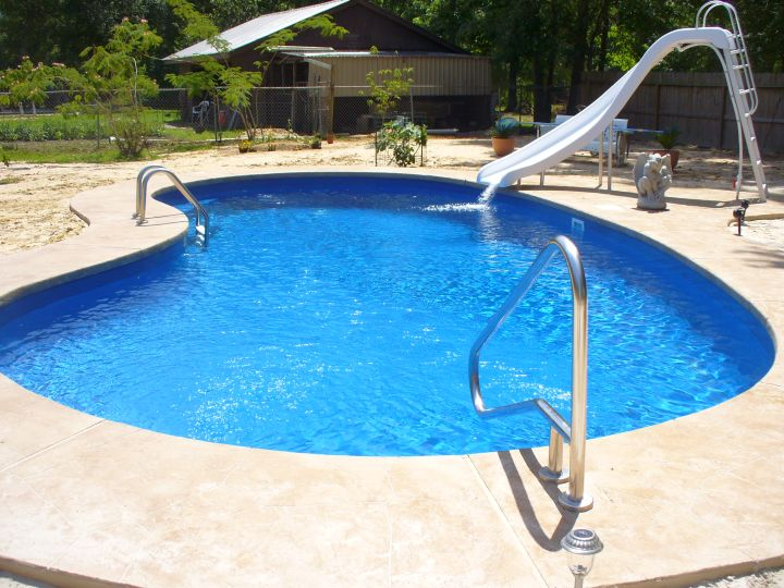 inground kidney shape pool with slide