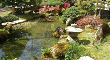 japanese garden designer with garden lamp and koi pond