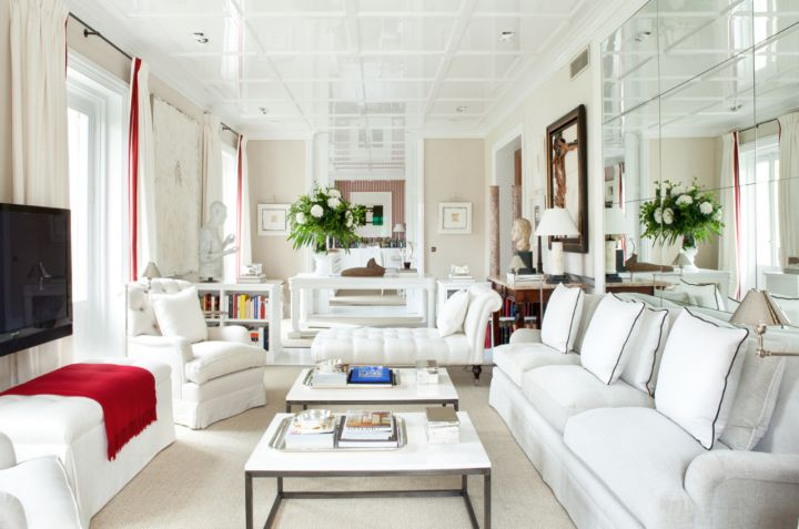 long living room in white with glass wall
