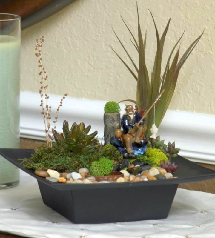 mini japanese garden with an old man