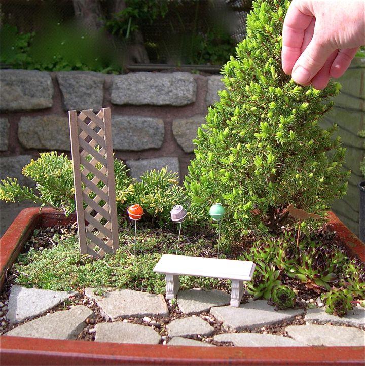 mini japanese garden with garden chair