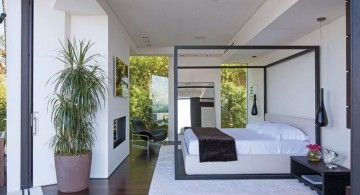 minimalist modern four poster bed on wide bedroom