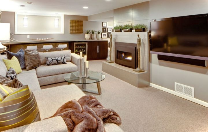 modern basement with mini bar and contemporary fireplace