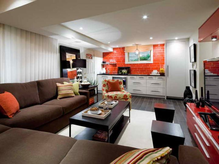 modern basement with red panel accent