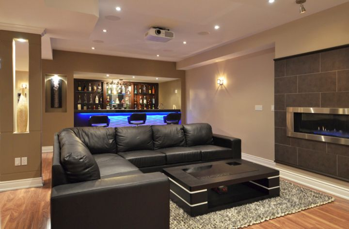 modern basement with sleek black sofa